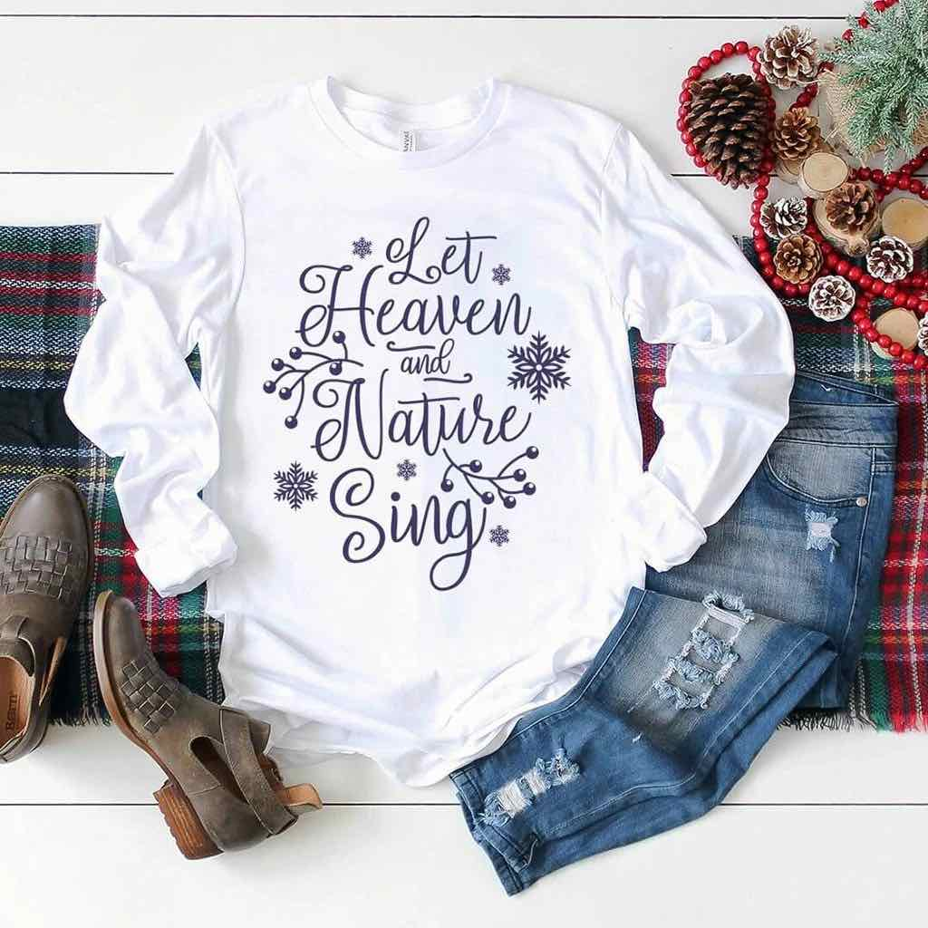 "Bright white Christmas shirt that reads ""let heaven and nature sing"""