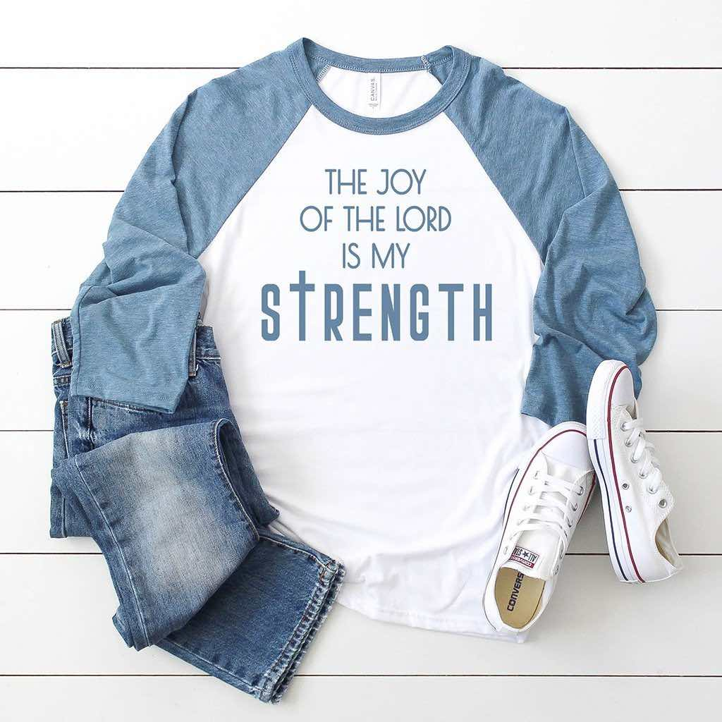 The joy of the Lord is my strength design printed on our premium blue and white raglan baseball tee