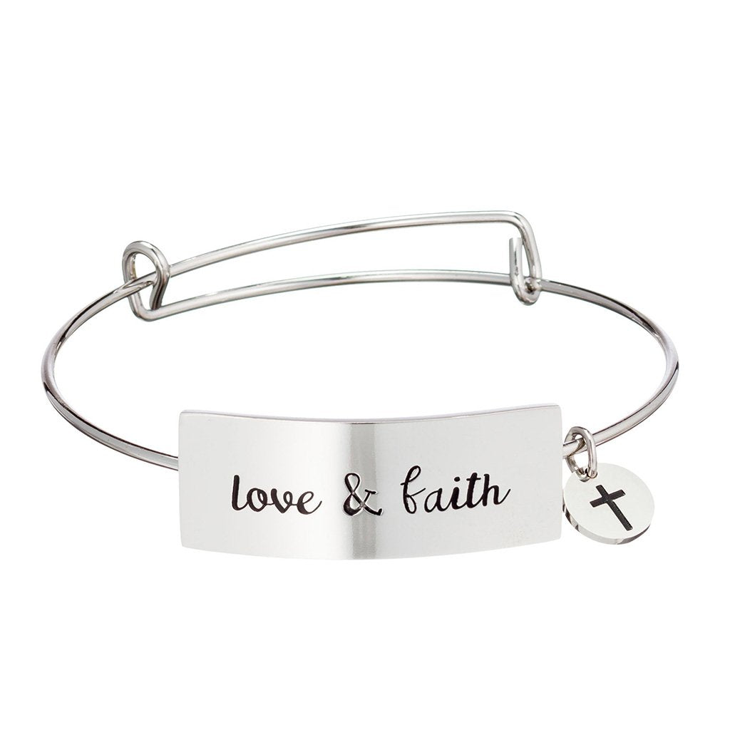 "Stainless steel bracelet with horizontal plate that reads ""love & faith"""