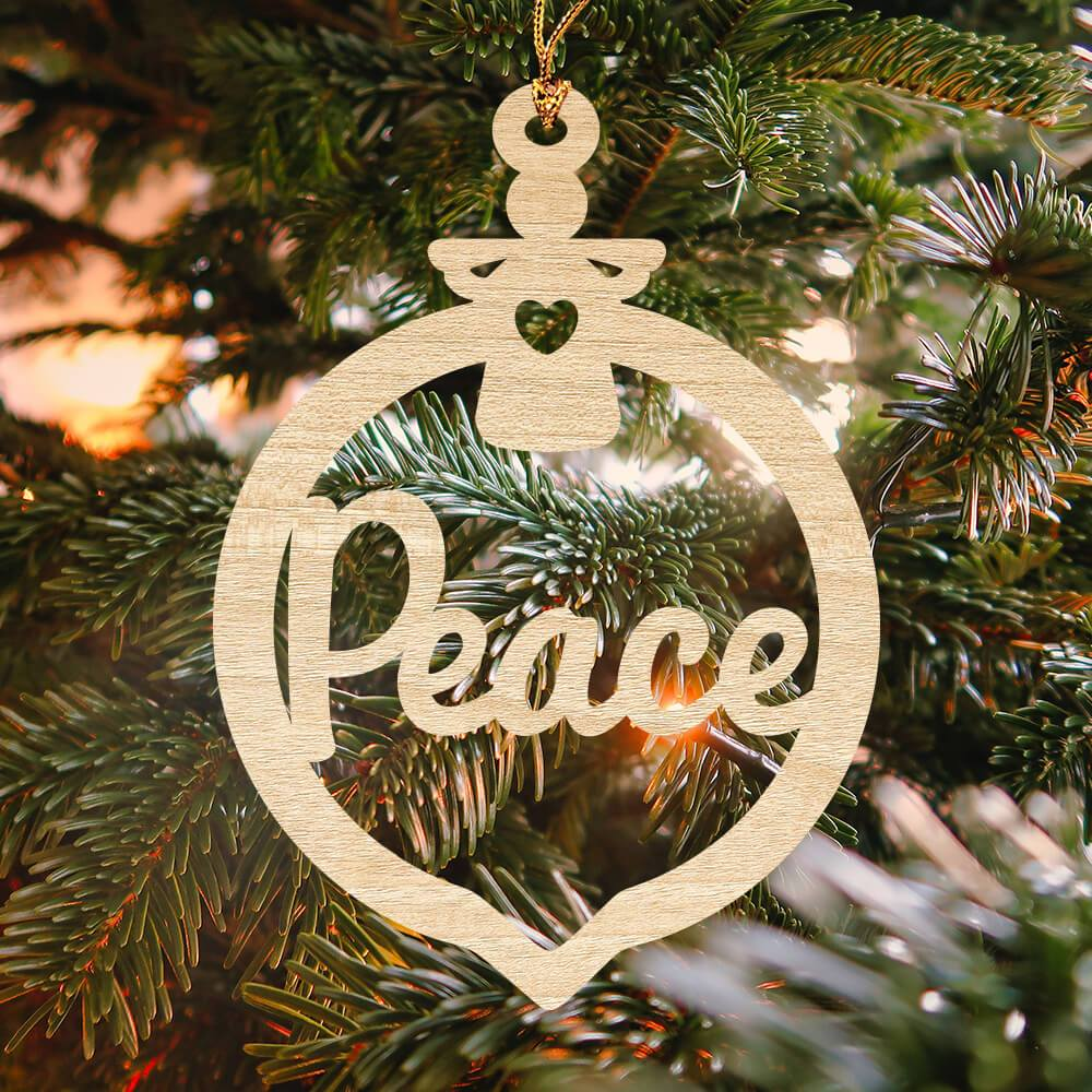"Wooden Christmas ornament that displays a small angel and the word ""peace"""