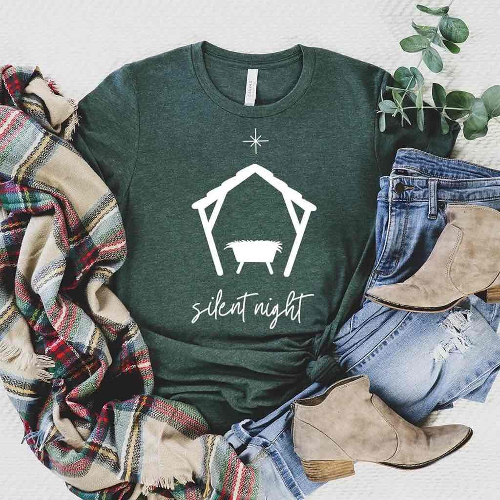 "Heathered green shirt for Christmas reads ""silent night"" and displays a peaceful manger setting with the north star"