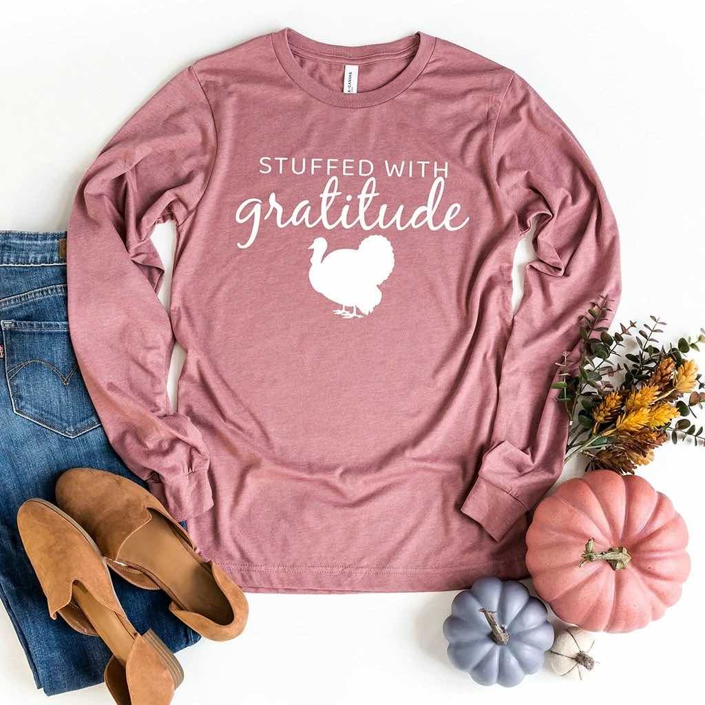 "Thanksgiving long sleeve shirt in mauve that reads ""stuffed with gratitude"""