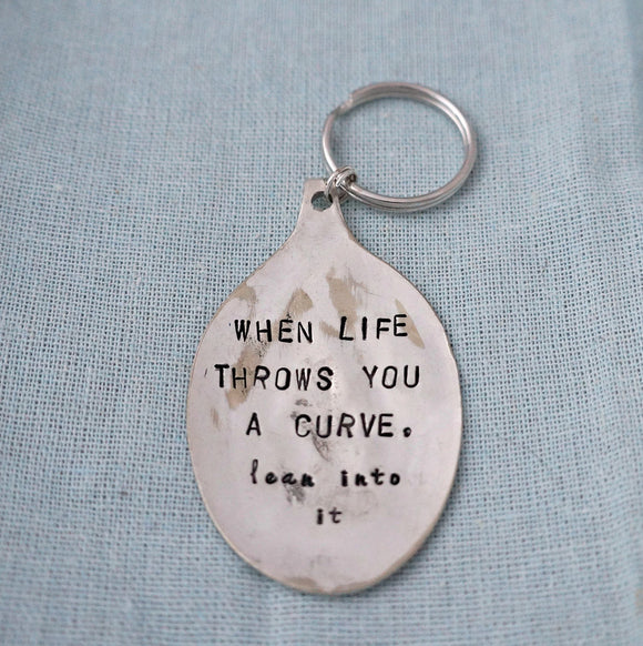 When Life Throws You A Curve, lean into it | Stamped Keychain