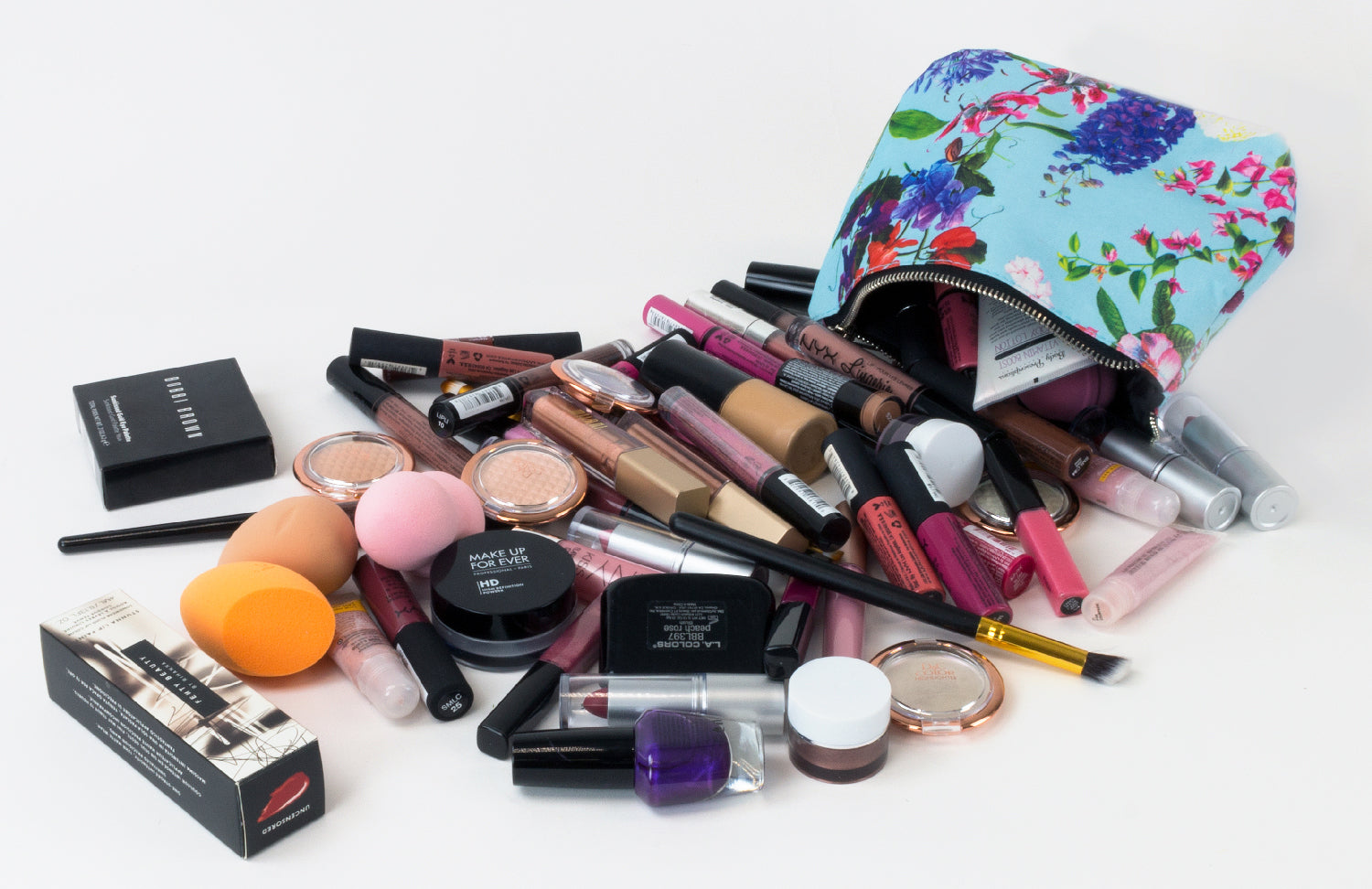a pile of makeup coming out of a cosmetic bag