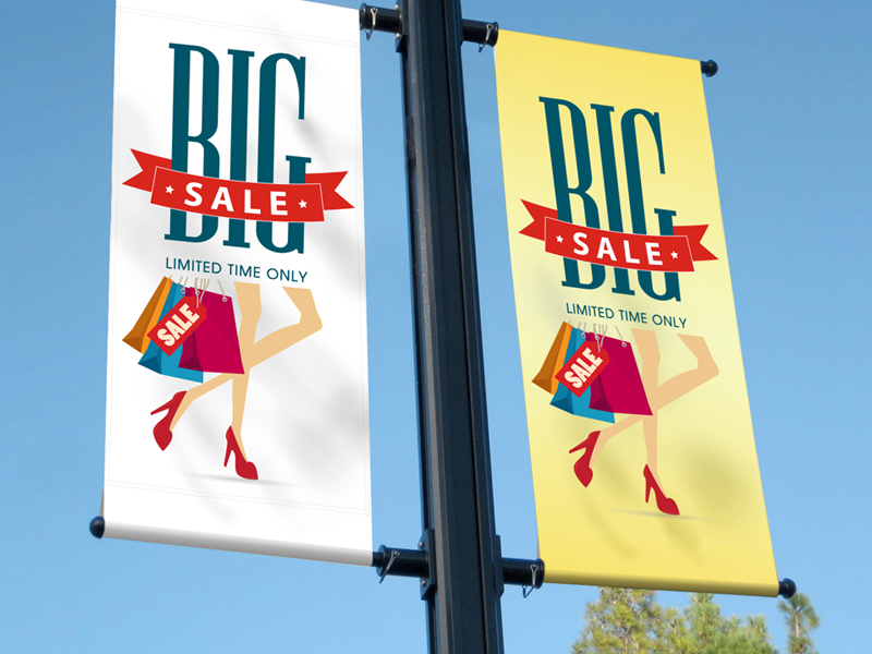 Two fabric banners showing limited time sale on the main street.