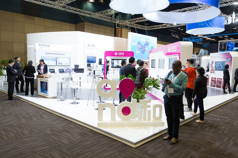 Exhibition at ITU Telecom World featuring a custom built stand.