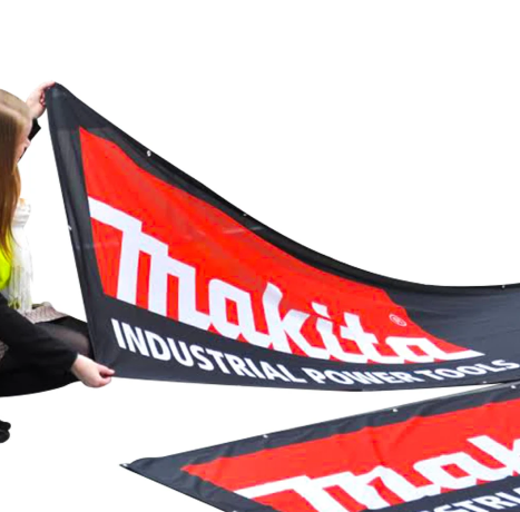 A Woman Holding a Fabric Banner