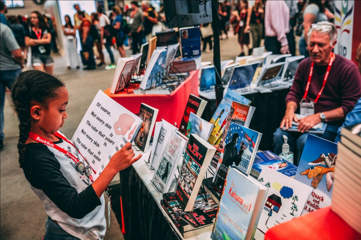 An image of a girl reading a book at a book stall