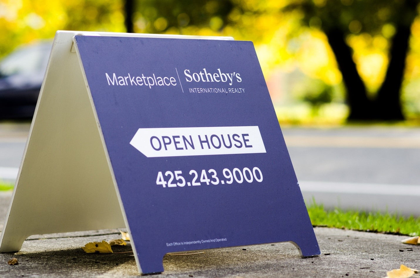 An open house sign on the road