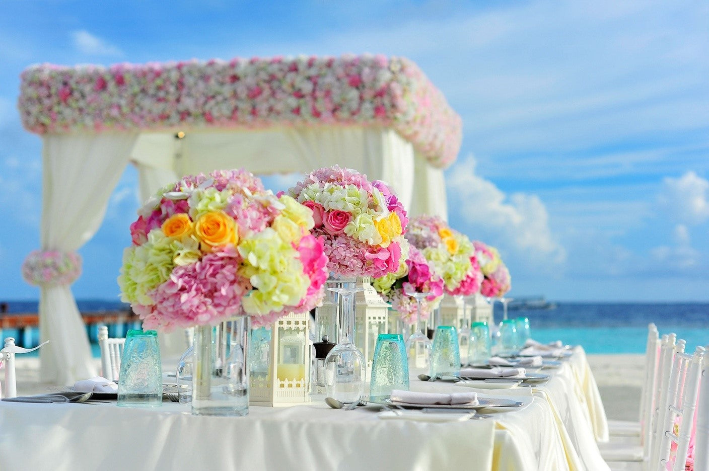 image of a white pop up gazebo at a wedding by the beach