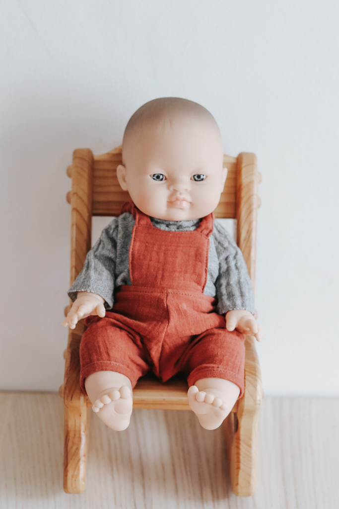 French Babydoll Asian Boy with Grey Top and Rust Overalls