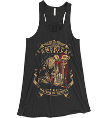 America A Nation of Heroes. Kneeling Soldier. Women's: Bella + Canvas Flowy Racerback Tank.