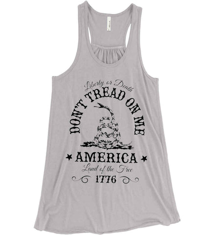Don't Tread on Me. Liberty or Death. Land of the Free. Black Print. Women's: Bella + Canvas Flowy Racerback Tank.