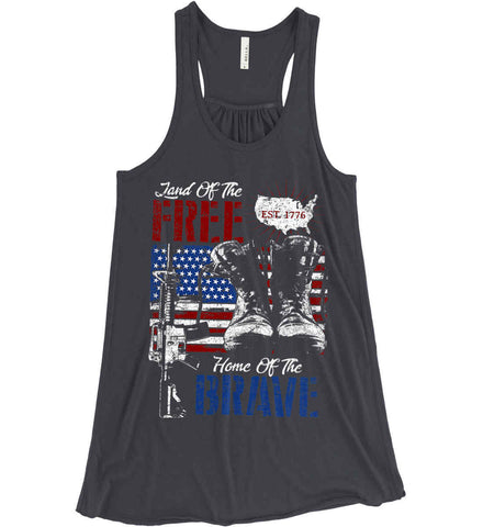 Land Of The Free. Home Of The Brave. 1776. Women's: Bella + Canvas Flowy Racerback Tank.