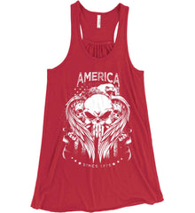 America. Punisher Skull and Bones. Since 1776. White Print. Women's: Bella + Canvas Flowy Racerback Tank.
