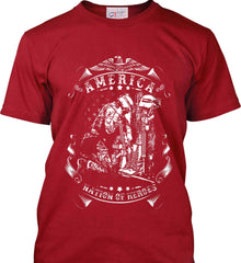 America A Nation of Heroes. Kneeling Soldier. White Print. Port & Co. Made in the USA T-Shirt.