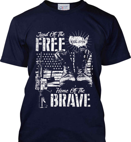 Land Of The Free. Home Of The Brave. 1776. White Print. Port & Co. Made in the USA T-Shirt.