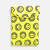 "16"" Puffy laptop sleeve from Baggu with happy yellow allover print blues store www.bluesstore.co"