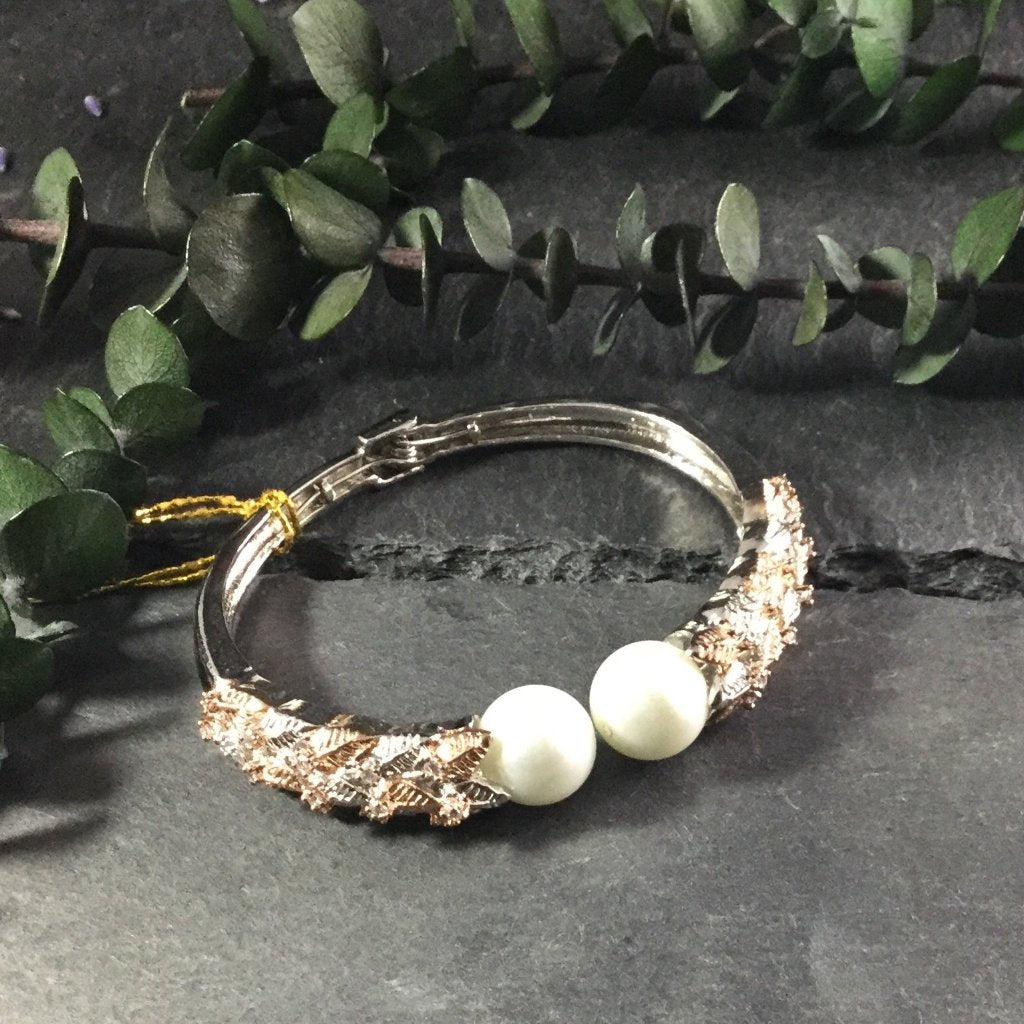 RS184B DOUBLE PEARL ROSE GOLD AND SILVER TONE BRACELET