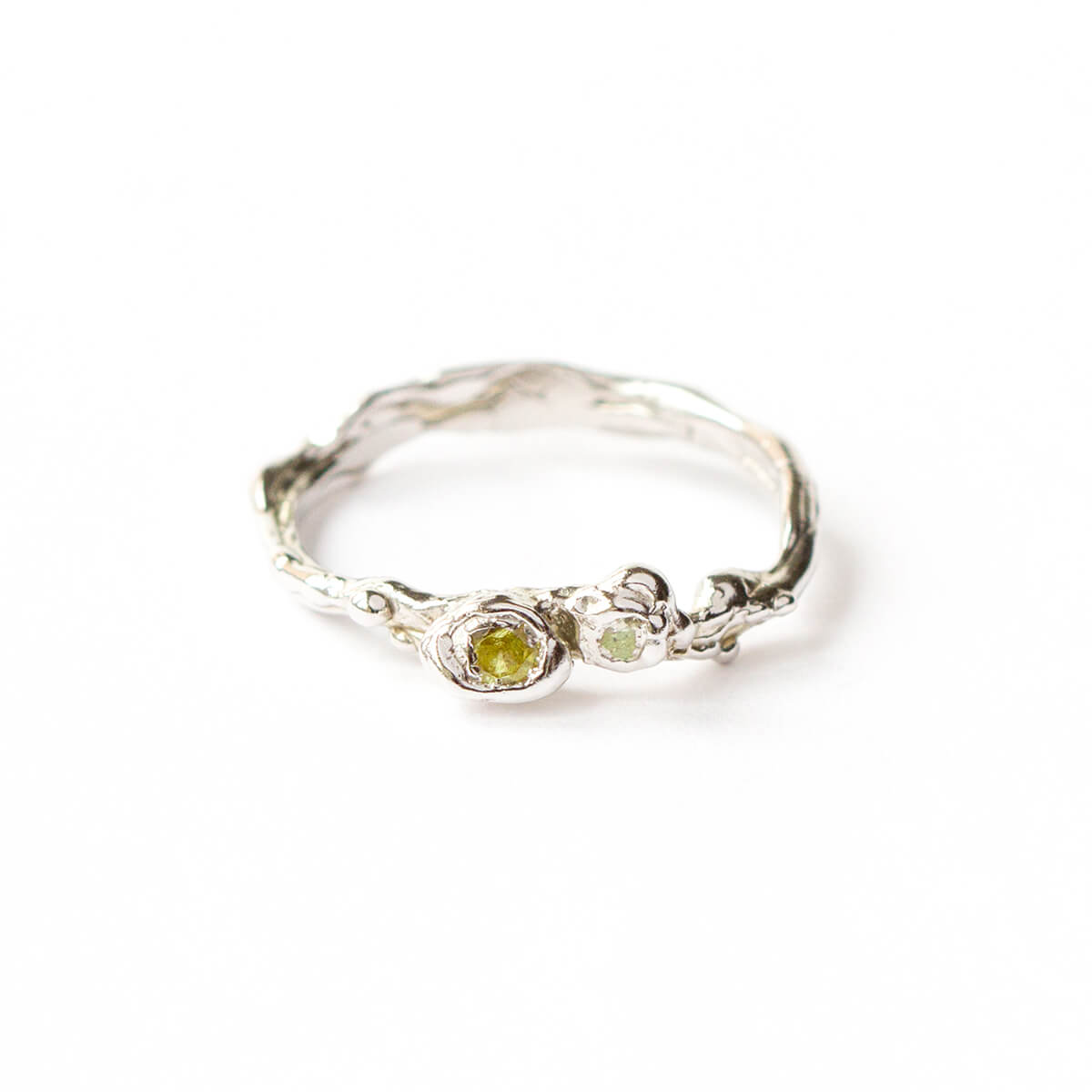 9kt White Gold Twig Ring With Green Sapphires