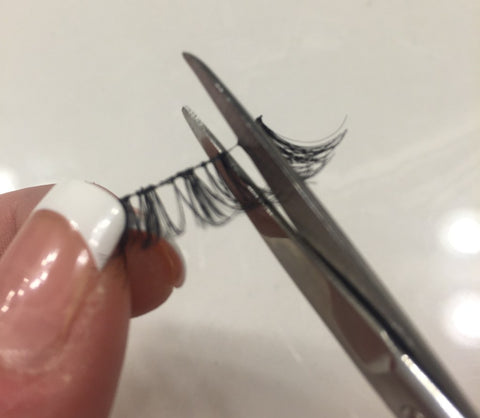 cutting false eyelash