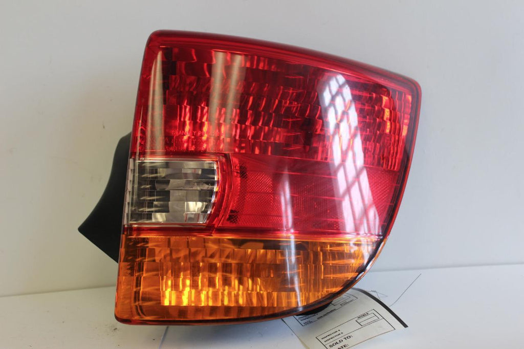 2000-2002 TOYOTA CELIA PASSENGER SIDE BRAKE TAIL LIGHT