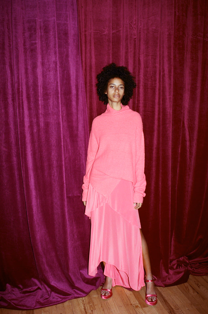 model backstage wearing pink Sies Marjan sweater and skirt