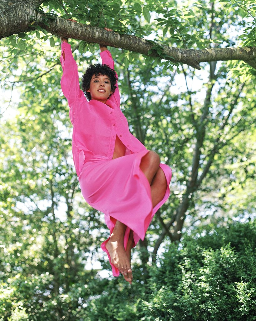 Model wearing pink shirt and skirt hanging from tree. Sies Marjan FW '17 Campaign shot by Bruce Weber.