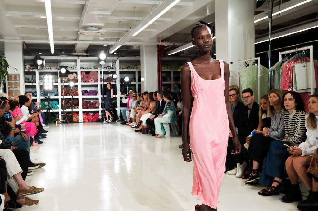 Wide angle image of model wearing pink dress walking the Sies Marjan SS'18 show runway
