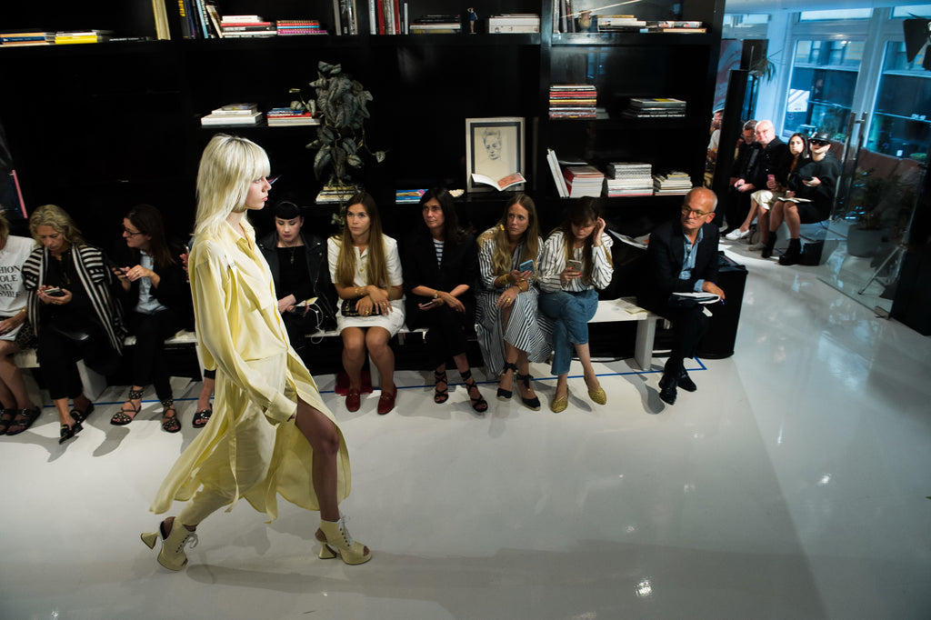 Wide angle image of model walking in yellow dress and shoes walking the Sies Marjan SS '18 show runway