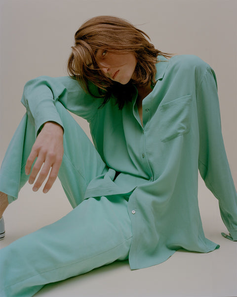 Made model seated wearing Sies Marjan turquoise shirt and pant