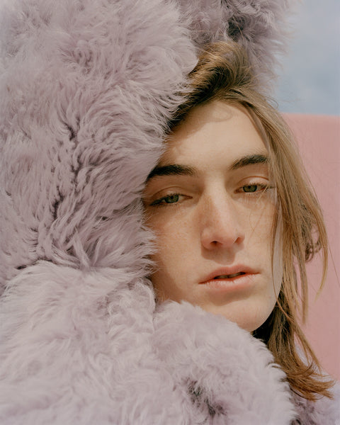 male model's face wrapped in Sies Marjan Pippa Shearling Peacoat in Mauve