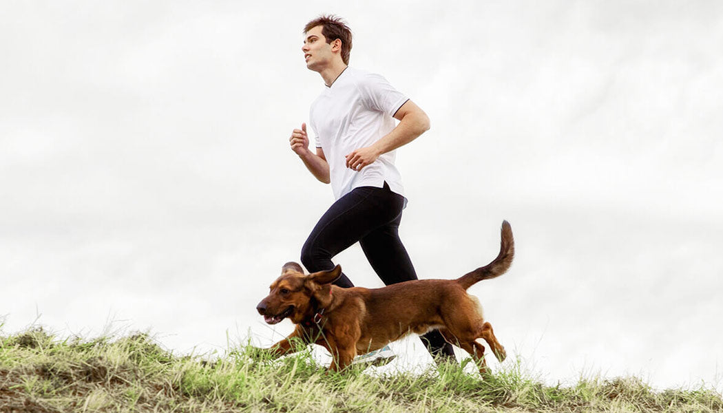a man and his dog running