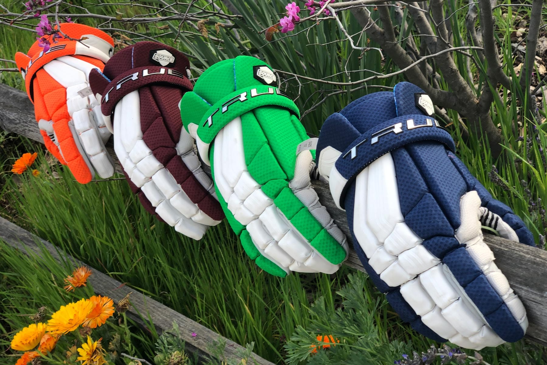 Custom gloves in your team colors from Lacrosse Fanatic
