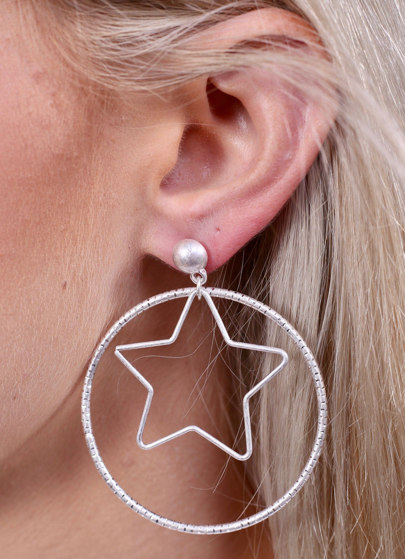 Gravity Worn Silver Star Earring - Caroline Hill