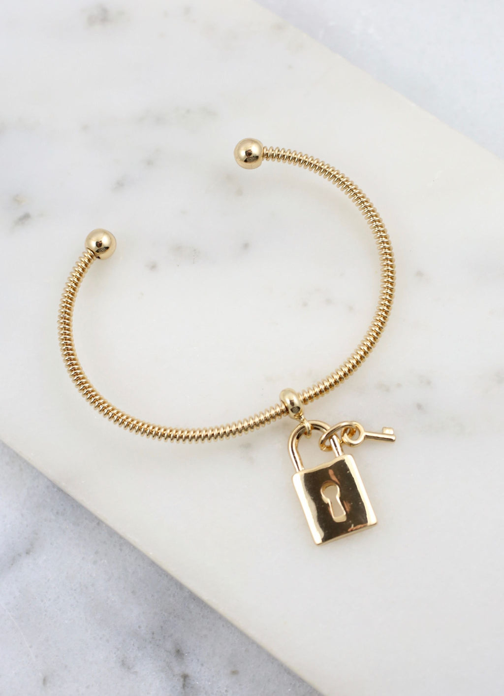 Jonathan Thin Cuff Bracelet With Lock Charm Gold - Caroline Hill