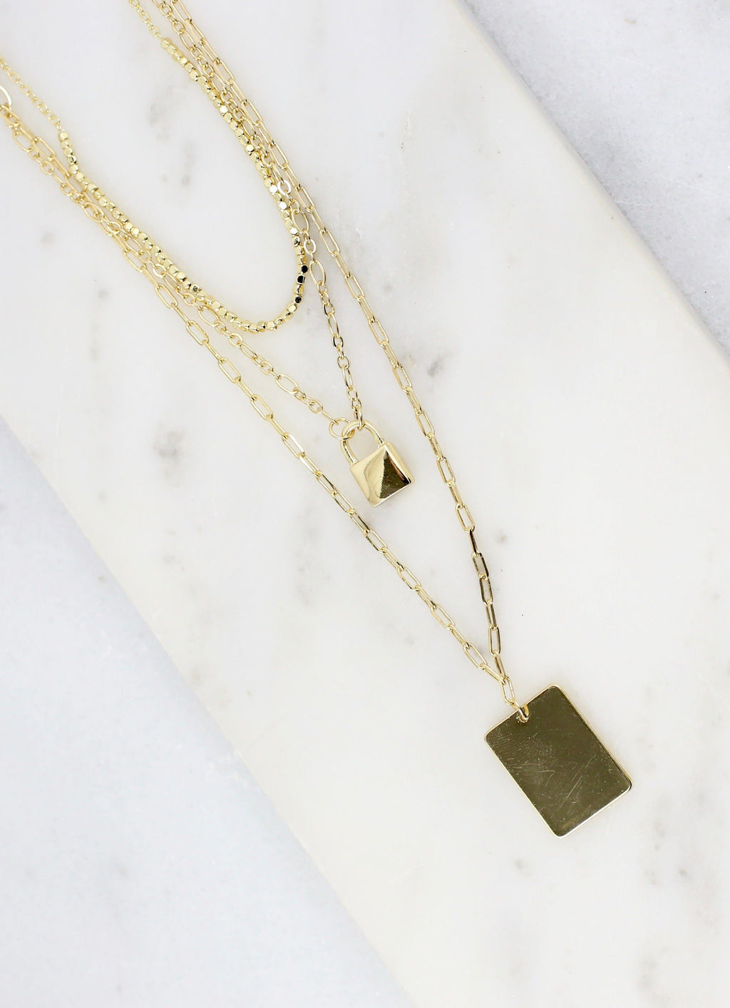 Lennie Gold Layered Metal Tag and Lock Necklace - Caroline Hill