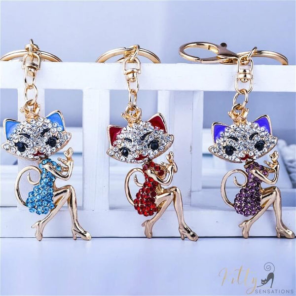 3 cat lady keychains in blue red and purple