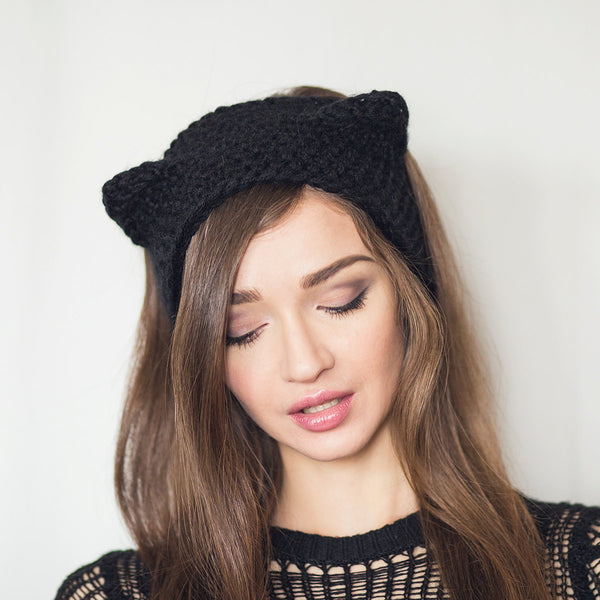 black cat ear warmers worn by woman kittysensations