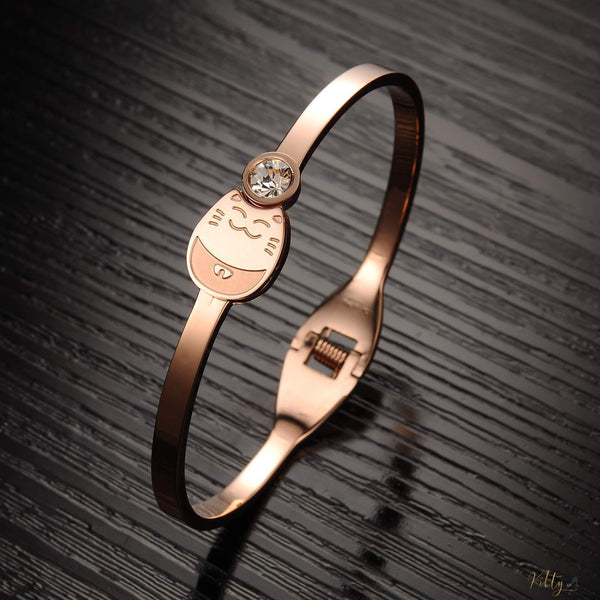 rose gold plated cat bracelet on black background