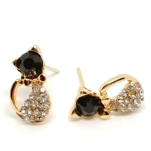 golden cat stud earrings on white surface 4984550-black-cat