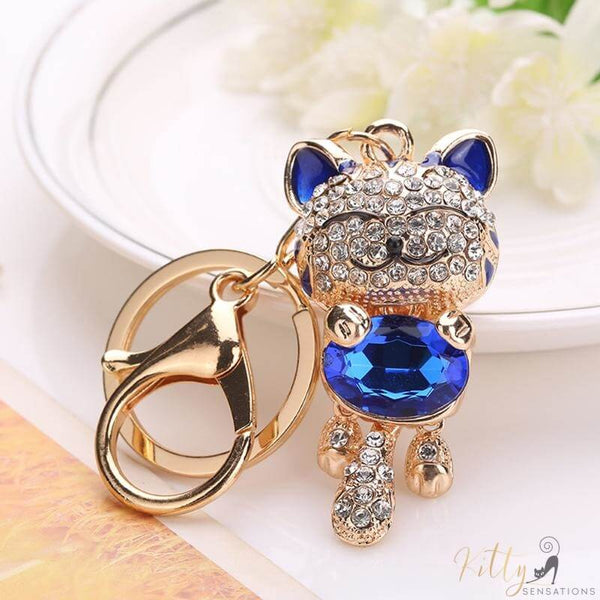 golden cat keychain with a blue gemstone kittysensations