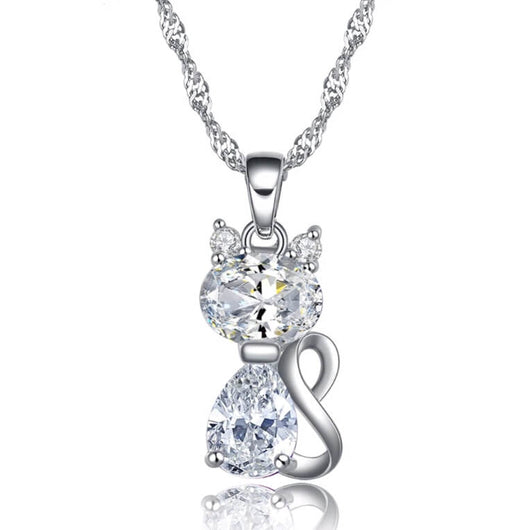 silver cat pendant necklace with clear berg crystals on white background