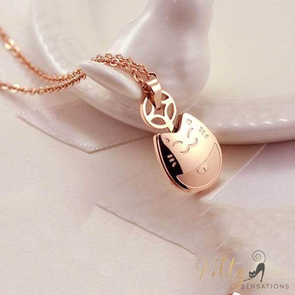 rose gold cat necklace on white background