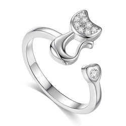 silver cat ring standing on a white background