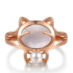 pearl cat ring plated in rose gold on white surface kittysensations