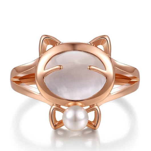 white pearl cat ring plated in rose gold on white surface kittysensations
