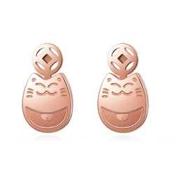 rose gold cat stud earrings on white background