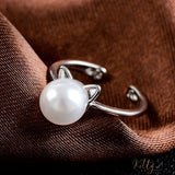 cute silver pearl cat ring with little paws on brown fabric 15731344-ring