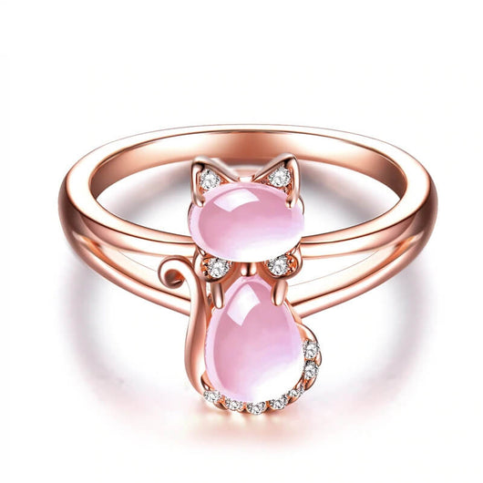 opal cat ring in 14k rose gold on white ground